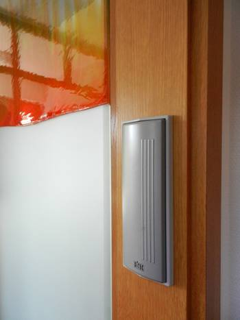 From the corridor, the door can be opened by a generously-sized pushbutton, this prevents unintentional opening while passing