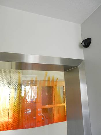The motion sensor opens the door from the kitchen automatically