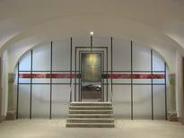 New minster, Würzburg, partition wall made of toughened safety glass with glass painting and sand-blasting, door in screen printing with glass paints, design by Klaus Zaschka