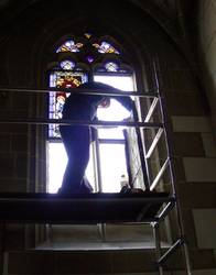 Careful visual examination of the exterior protective glazing prior to the assembly of the conserved medieval glass paintings.